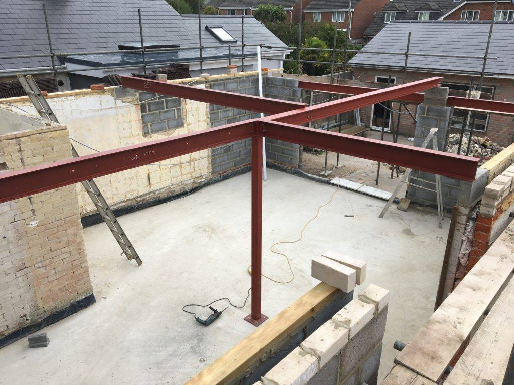 Fabricated steel including, 178x102x19 Universal beams, 90x90x5mm wind posts, 152x89x16 Universal beams, 152x152x23 Universal columns.